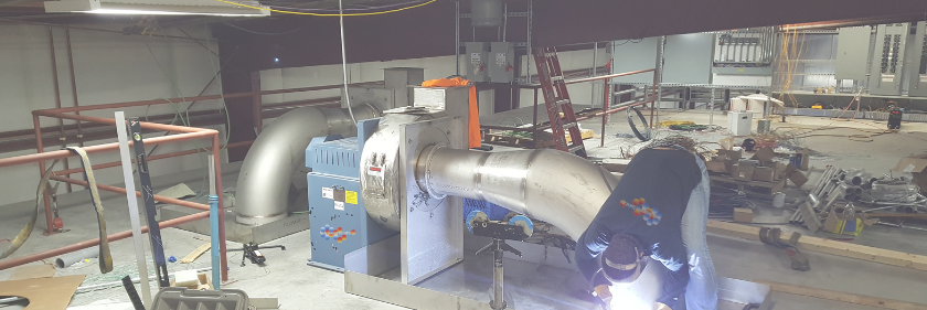 Image shows commercial HVAC fabrication and welding by a technician at Nordic Temperature Control, Burlington, WA.